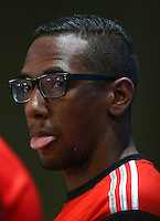 Jerome Boateng of Germany sticks his tongue out during a press conference ahead of tomorrow's semi final vs Brazil
