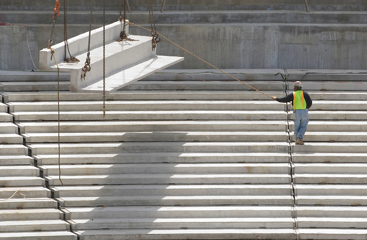 After announcing next year's season ticket prices, the Washington Nationals took the media on a tour of their new stadium on Wednesday, June 6, 2007. A construction worker is shown guiding a section of upper deck seating into position.