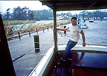 A man turns away from the wind and stinging rain as he tries to throw another rope around a post as the storm surge from Hurricane Kate covers the walkway cutting off he and his wife's avenue of escape in the Apalachicola boat basin in Apalachicola, Florida November 21, 1985.  Kate, a late November Hurricane,  was latest forming Atlantic hurricane on record at the time and was the second for the area following Hurricane Elena two months earlier.