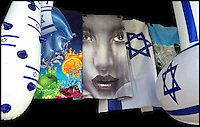 2. &quot;Jaffa is more than Oranges&quot;:  beach towels and inflatable toys in a shopfront display, Tel Aviv.<br /> <br /> When I first made this image in Tel Aviv, what struck me hard was the Semitic face emblazoned on a bath towel. Flanked by the Israeli flag and Jewish stars of David, this storefront seemed to trumpet pride in a quintessentially Jewish nation-state; yet the exaggerated classic Semitic face could represent an Arab or Jew.<br />  <br /> Tel Aviv was founded in 1909 on the outskirts of the ancient port of Jaffa by Jewish immigrants, many of whom bought orange groves from Jaffa's Arab residents and developed a thriving agricultural trade. But in 1921, this &quot;harmonious co-existence&quot; erupted into riots between Arabs and Jews, who then moved en masse to Tel Aviv. Today, Tel Aviv is the 2nd largest city in Israel (after Jerusalem) and, according to the Global Financial Centres Index, is the 25th most important financial center in the world. So now I wonder, what do these towels signify?