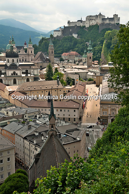 Historic downtown with views of Salzburg Cathedral, other church towers including St. Peter's Cemetery, and Hohensalzburg Fortress