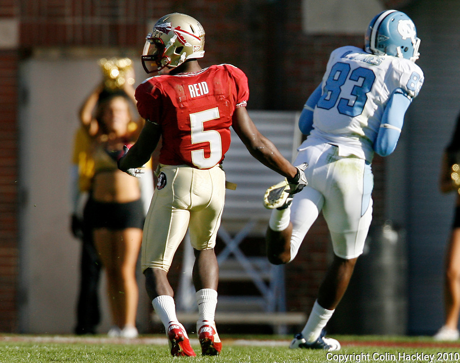 TALLAHASSEE, FL 11/6/10-FSU-NC FB10 CH-Florida State's Greg Reid pulls up from chasing North Carolina's Dwight Jones  after he caught a 67-yard pass for the Tar Heel's second touchdown during first half action Saturday at Doak Campbell Stadium in Tallahassee. The Tar Heels beat the Seminoles 37-35. .COLIN HACKLEY PHOTO