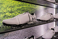 Under Armour brand golf shoes in the new Dick's Sporting Goods store in the Glendale neighborhood of Queens in New York during its grand opening sales on Saturday, March 11, 2017. The new store is in a location formerly occupied by the now closed Sports Authority.  (© Richard B. Levine)