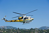 LA County Fire fighting helicopter flies in skies above Santa Barbara, California during Jesusita fire, May 6, 2009