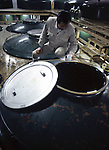 A quality control manager checks the fermentation of a batch of sake at a sake factory near Hachinohe, Japan. (Jim Bryant Photo)........