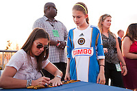 USWNT Olympic gold medalist Carli Lloyd signs autographs for fans before the match. The Columbus Crew defeated the Philadelphia Union 2-1 during a Major League Soccer (MLS) match at PPL Park in Chester, PA, on August 29, 2012.