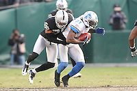 December 18, 2011 Oakland, CA: Detroit Lions wide receiver Calvin Johnson #81 and Oakland Raiders cornerback Stanford Routt #26 during an NFL game played between the Oakland Raiders and the Detroit Lions at O.co Coliseum. The Lions defeated the Raiders 28-27.