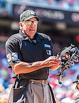 25 July 2013: MLB Umpire and Crew Chief Mike Winters works behind the plate during a game between the Pittsburgh Pirates and the Washington Nationals at Nationals Park in Washington, DC. The Nationals salvaged the last game of their series, winning 9-7 ending their 6-game losing streak. Mandatory Credit: Ed Wolfstein Photo *** RAW (NEF) Image File Available ***