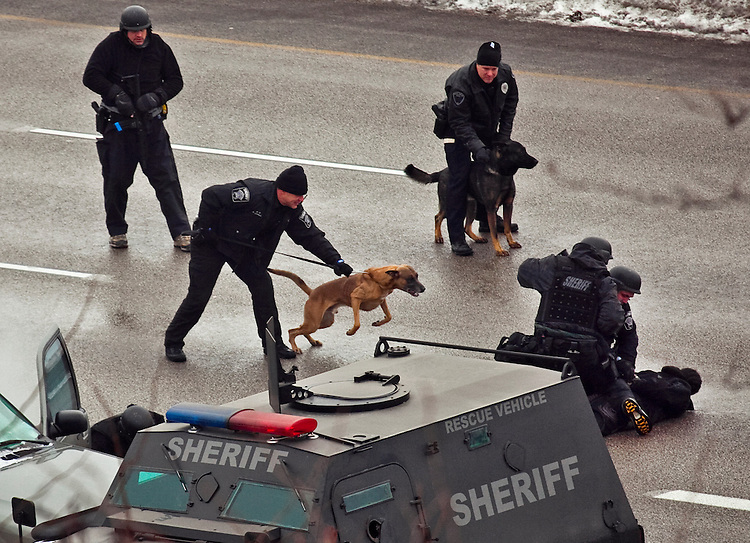 standoffp2, mjs, news - After throwing in a can of tear gas and forcing the suspect out of the car, the tactical team apprehends him on I-94 westbound after a six hour standoff, in Milwaukee on Friday, December 10, 2010. PHOTO BY MARK ABRAMSON/MABRAMSON@JOURNALSENTINEL.COM