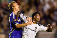 LA Galaxy forward Edson Buddle gives an elbow to the adams apple of Kansas City Wizards midfielder Jimmy Conrad. The Kansas City Wizards beat the LA Galaxy 2-0 at Home Depot Center stadium in Carson, California on Saturday August 28, 2010.