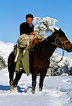Kazaks are an ethnic minority group who are nomadic. Most live in the mountains, their way of life is like that of the Mongols on the steppe. They are good horsemen, keep sheep and goats and live in yurts in the summer.