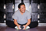 Los Angeles Chef Sang Yoon demonstrates a hip opening exercise at Toyota Sports Center in El Segundo, California December 17, 2015.<br /> <br /> CREDIT: Kendrick Brinson for The Wall Street Journal