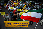 People shout slogans against United Nations and Iranian government during a protest outside UN headquarter in New York, July 19, 2012.  UN Security Council vetoed a resolution that would impose sanctions against Syria's President Bashar al-Assad if he does not end the use of heavy weapons.  as members of the 15-nation council to block resolutions on Syria. Photo by Eduardo Munoz Alvarez / VIEW.