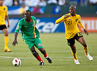 CARSON, CA – June 6, 2011: Greneda player Patrick Modeste (19) moves away from Jamaican Luton Shelton (21) during the match between Grenada and Jamaica at the Home Depot Center in Carson, California. Final score Jamaica 4 and Grenada 0.