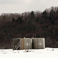 View of brine water tanks near a gas production unit off Carter Road in Dimock, PA, USA, 25 March 2011. Carter Road has become the epicenter of the controversy over the use of so-called fracking to extract natural gas. Several residents have  accused the wells of polluting their drinking water.