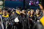 Students from the College of Arts and Sciences pause for a selfie at the conclusion of Ohio University's Graduate Commencement ceremony  on Friday, May 1, 2015.  Photo by Ohio University  /  Rob Hardin