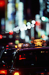 Row of taxis parked on the Ginza at night. Tokyo, Japan, Asia.