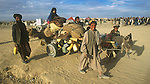 An Afghan refugee family crosses the border into Pakistan at Chaman..