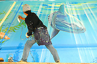 Artist David Legaspi paints a mural underneath the Santa Monica the pier on Friday April 20, 2012.