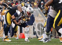 PITTSBURGH, PA - OCTOBER 30:  Tom Brady #12 of the New England Patriots is sacked by LaMarr Woodley #56 of the Pittsburgh Steelers during the game on October 30, 2011 at Heinz Field in Pittsburgh, Pennsylvania.  (Photo by Jared Wickerham/Getty Images)