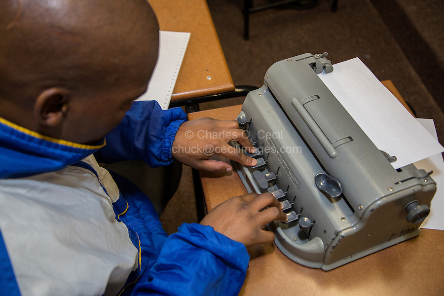 South Africa, Cape Town. Blind Student Typing on a Perkins Brailler.  Athlone School for the Blind.