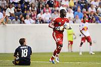 Mike Magee (18) of the Los Angeles Galaxy looks up at New York Red Bulls goalkeeper Bouna Coundoul (18) after a failed goal scoring attempt. The Los Angeles Galaxy defeated the New York Red Bulls 1-0 during a Major League Soccer (MLS) match at Red Bull Arena in Harrison, NJ, on August 14, 2010.