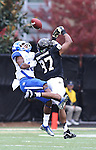 UK cornerback Cody Quinn blocks a pass to Vanderbilt wide receiver Jordan Matthews during the first half of the University of Kentucky vs. Vanderbilt University football game at Vanderbilt Stadium in Nashville, Tenn., on Saturday, November 16, 2013. Vanderbilt won 22-6. Photo by Tessa Lighty | Staff