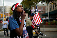 A woman looks on during a march against police brutality in Staten Island. 08.23.2014. Eduardo Munoz Alvarez/VIEWpress