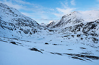 Winter view towards Stauerdalen mountain valley, Flakstadøy, Lofoten Islands, Norway