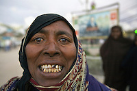 Somaliland. Waqohi Galbed province. Hargeisa. Old black muslim woman, wearing a veil on the head, smiles and shows her teeth. Somaliland is an unrecognized de facto sovereign state located in the Horn of Africa. Hargeisa is the capital of Somaliland. © 2006 Didier Ruef