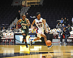 Ole Miss' Amber Singletary (20) dribbles against Southeastern Louisiana's Symone Miller (24) in Oxford, Miss. on Friday, November 9, 2012. (AP Photo/Oxford Eagle, Bruce Newman)