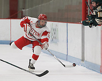 Boston, Massachusetts - February 28, 2015: NCAA Division I. Women's Hockey East 2015 Quarterfinal. Boston University (white/red) defeated University of Vermont (green), 7-2, at Walter Brown Arena, and advances to semifinals.