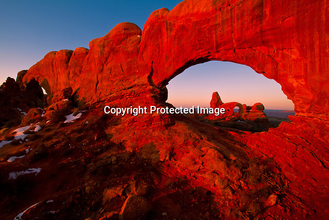 Turret Arch seen through the North Window Arch in Arches National Park outside Moab, Utah at Sunrise.<br /> Jim Urquhart/straylighteffect.com<br /> 03/12/2010