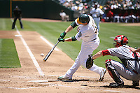 OAKLAND, CA - June 20:  Jack Cust of the Oakland Athletics bats during the game against the Cincinnati Reds at the McAfee Coliseum in Oakland, California on June 20, 2007. Photo by Brad Mangin