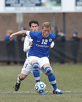Under pressure, Creighton University midfielder Zach Barnes (12) collects a pass. .NCAA Tournament. Creighton University (blue) defeated University of Connecticut (white), 1-0, at Morrone Stadium at University of Connecticut on December 2, 2012.