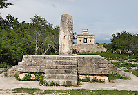 Structure 12 with Monolith, with the Temple of the Seven Dolls in the distance, Platform of 1,4 meters high with four staircase on each side and the monoilith in the center, Dzibilchaltun (500 BC - 1500 AD), Yucatan, Mexico. Picture by Manuel Cohen