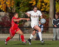 Boston College midfielder Zoe Lombard (20) brings the ball out of defensive zone as Marist College forward/midfielder Nicole Kuhar (11) closes. Boston College defeated Marist College, 6-1, in NCAA tournament play at Newton Campus Field, November 13, 2011.