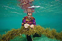 Juni, a seaweed farmer from Caluya attaches a styrofoam float to one of his seaweed lines.