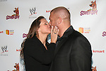 WWE Chief Brand Officer Stephanie McMahon and WWE Superstar Triple H Share A Kiss At the  World Premiere of Scooby Doo! WrestleMania Mystery Held at Tribeca Cinemas, NY
