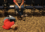 Matthew Huff sleeps on the floor of the Georgia State University ballroom during the 48th annual Georgia Spelling Bee. Huff's brother competed in the state spelling bee.