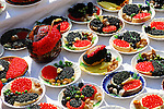 Stock photo of Ukrainian arts and crafts Decorative sandwiches with red and black caviar on plates Kiev Ukraine Eastern Europe
