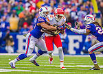 9 November 2014: Kansas City Chiefs wide receiver Dwayne Bowe is tackled by Buffalo Bills inside linebacker Preston Brown with Bills cornerback Stephon Gilmore (24) looking on after a 7-yard gain in the second quarter at Ralph Wilson Stadium in Orchard Park, NY. The Chiefs rallied with two fourth quarter touchdowns to defeat the Bills 17-13. Mandatory Credit: Ed Wolfstein Photo *** RAW (NEF) Image File Available ***