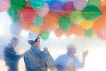 Friends gather balloons to pass out at the memorial service for Sun City resident Monte Haag, who moved to Sun City in 2000 and died in December 2010. He died in a crash flying an ultralight plane outside of Sun City. The service was held in Social Hall No. 1 of the Bell Recreation Center and the balloons were released from a tennis court Monte played on often in Sun City, Arizona December 11, 2010...2010 marks the 50th anniversary of Sun City, America's first retirement city that remains the largest today with more than 40,000 residents 55 and older.