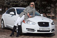Krasnodar, Russia, 17/03/2009..World champion heptathlete Tatyana Chernova with her favourite car, a Jaguar. Chernova, who won bronze in the Beijing Olympic Games, is tipped for gold in London.