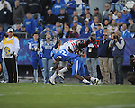 Ole Miss' Donte Moncrief (12) is tackled by Kentucky's Randall Burden (24) at Commonwealth Stadium in Lexington, Ky. on Saturday, November 5, 2011. Kentucky won 30-13...