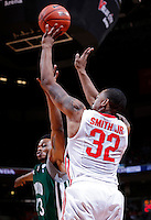 Ohio State Buckeyes guard Lenzelle Smith Jr. (32) gets fouled as he shoots a three-point shot by Ohio Bobcats guard/forward T.J. Hall (13) in the second half of the college basketball game between the Ohio State Buckeyes and the Ohio Bobcats at Value City Arena in Columbus, Tuesday evening, November 12, 2013. The Ohio State Buckeyes defeated the Ohio Bobcats 79 - 69. This was the first meeting of the teams in 19 years and the first ever game between them at Value City Arena. (The Columbus Dispatch / Eamon Queeney)