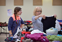 NWA Democrat-Gazette/BEN GOFF -- 05/23/15 Alexa Wimberly of Fayetteville shops with her grandmother Anne Earle, visiting from Springfield, Mo., during the rummage sale at Good Shepherd Lutheran Church in Fayetteville on Saturday May 23, 2015. The sale, which will continue Saturday May 30 from 8:00a.m. to 3:00p.m., helps support the church's youth programs.
