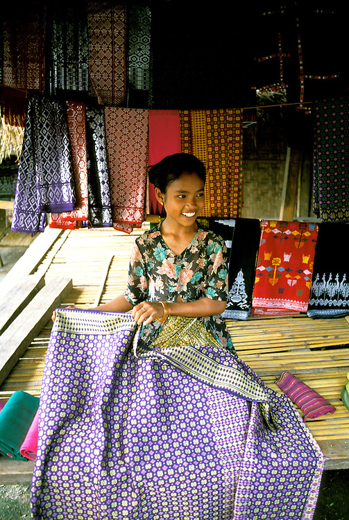 Indonesia: Lombok Island, Sasak Village, Rambitan, handicrafts, home woven cloth,  Photo: baliin104.Photo copyright Lee Foster, 510/549-2202, lee@fostertravel.com, www.fostertravel.com