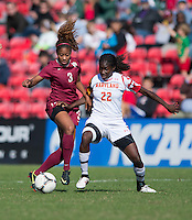 Shade Pratt (22) of Maryland fights for the ball with Casey Short (3) of Florida State during the game at Ludwing Field in College Park, MD.  Florida State defeated Maryland, 1-0.