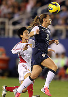 BOCA RATON, FL - DECEMBER 15, 2012: Christie Rampone (3) of the USA WNT heads away from Wu Haiyan (26) of China WNT during an international friendly match at FAU Stadium, in Boca Raton, Florida, on Saturday, December 15, 2012. USA won 4-1.